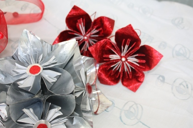 centerpiece of silver flowers and red ones